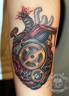 Amazing steampunk heart tattoo, done by Tim Kern
