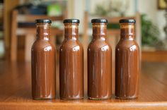 Homemade Barbecue Sauce + Canning in Sauce Bottles with Lug Lids  four finished jars of barbecue sauce