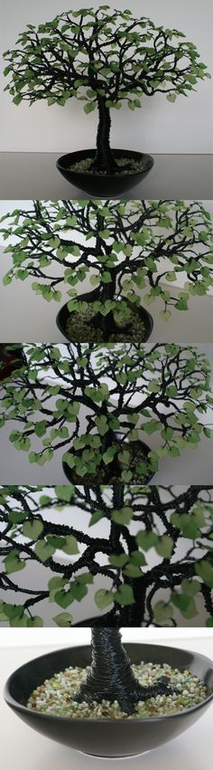 Wire tree cemented in bowl from dollar store with glass pebbles on top. The leaves are beads from Wholesale Lucite Flower Beads.