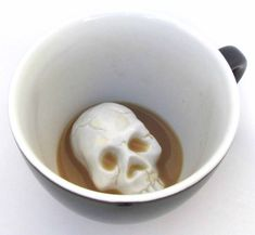 Hidden creepers at the bottom of your cup. Skull. Cup is black.    As you drink the Skull will emerge. Cups are handmade, dishwasher safe, microwavable, and hold 11 oz.