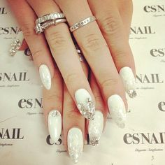 White stiletto nails. I like the color and design but not the shape of the nails.