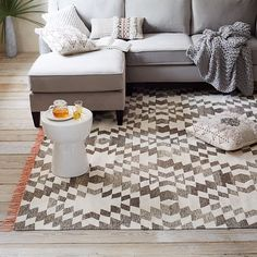 Pop art. The traditional kilim pattern on the Palmette Rug gets a modern update with its mixed chenille and heathered wool construction and bold, contrast fringe. It's handwoven in a Fair Trade Certified™ facility, meaning that each rug purchased directly improves the life of the artisan who makes it.