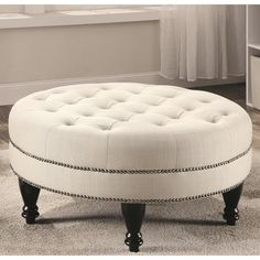 Fortune Beige Fabric and Wood Round Button-tufted Nailhead-trimmed Ottoman