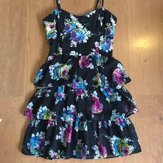 Aeropostale floral ruffle corset dress small black Black spaghetti strap dress. Corset top is made of a knit material and the bottom ruffles are made from a tulle/chiffon. Ruching at the back. So cute. Aeropostale size small. Aeropostale Dresses