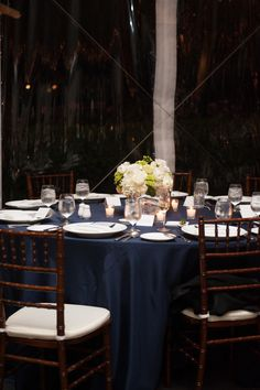 Love the blue table cloth with green and white flower centerpiece. Newport Wedding from Robert & Kathleen + Unique Visions Studio http://www.stylemepretty.com/2013/05/15/newport-wedding-from-robert-kathleen-unique-visions-studio/