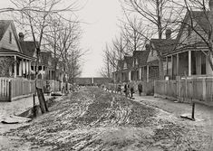 """Mudville: January 1909. """"Augusta, Georgia. A typical street scene in Gregtown where the employees in King Mill live. The Secretary of Associated Charities said this is the most degraded part of Augusta."""" Photo by Lewis Wickes Hine."""