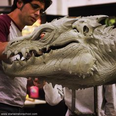 Draw Creatures It's sculpting time. In this behind the scenes photo lead creature effects artist Chris Swift at work sculpting in clay a Zorgon costume at Stan Winston Studio created for the film Zathura: A Space Adventure from Pottery Sculpture, Sculpture Clay, Creature Drawings, Animal Drawings, Creature Feature, Creature Design, Dragon Medieval, Clay Monsters, Dragon Figurines