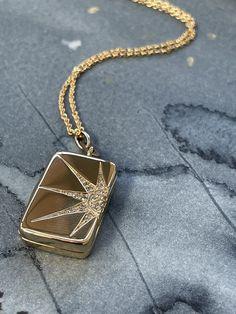 sun and star locket with diamonds