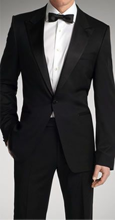 Grooms men in grey tuxes, black buttons.  Black bow tie.  Blue green accent in boutineeer.  Like this lapel.