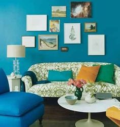 Peacock blue walls teal walls paint color - white & green upholstered sofa, glass lamp, peacock blue slipper chair, marble saarinen cocktail table, blue orange green pillows and eclectic art gallery. Teal Rooms, Teal Living Rooms, Eclectic Living Room, Teal Walls, Living Room Paint, Turquoise Walls, Color Walls, Green Walls, Green Turquoise