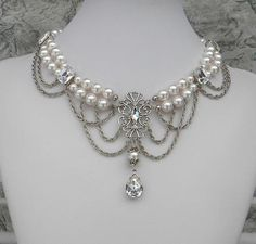 White Swarovski crystal pearlsand rhinestone, a pear pendant dangles with chain swags, a beautiful bridal necklace. #pearl #white #bridal