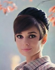 A publicity shot of Audrey Hepburn on the Paris set of How to Steal a Million, November '65. Hat and coat: Givenchy. Photo: Douglas Kirkland.