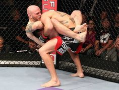 Justin Edwards secures a guillotine choke submission to defeat Josh Neer at UFC on FX.