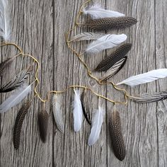 This feather garland is a work of art and is the perfect accent to use as party decoration or to hang in the home. The garland measures 60. A