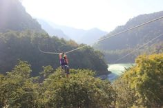 Do you have the zeal to feel something like this!!! #ziplines # ziplininginrishikesh #rishikesh  Fly High across Ganges... the Sacred River of India in Rishikesh. Soaring high above this gurgling and gushing river gives the adventurers the adrenaline rush they yearn for. Grab this opportunity to feel at the top of the world while you zip across Ganges. Feel the gush of air as you swish toward the other end. This is the most sought after adventure of the era.