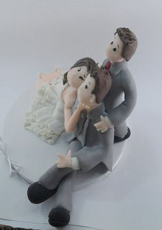 #Wedding #Cake topper.   This is an example of a custom made Wedding Cake topper that I created, #Bride pulling Groom. I can customize the dress and tux just for you!   For a ... #cake #children #birthday #clay #biscuit #bride #groom #wedding