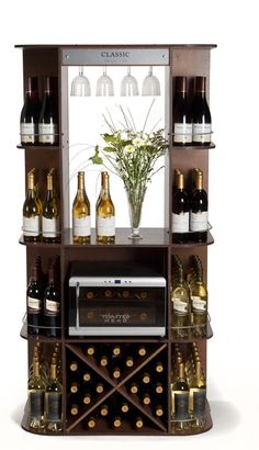 This multi-brand display was designed for @BroncoWineCo to showcase their products. The home bar concept featured high-end materials and a built-in wine fridge. Its flexible design allowed for cross merchandising wine with partner products. // #POPDisplays #WineBar #WineDisplay