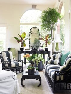 Solarium designed by John Oetgen for Atlanta Symphony Showhouse. Perfect for everything from coffee to cocktails.   Photo: Emily Followill