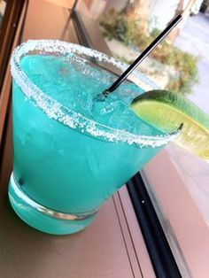 Electric Blue Margarita    1½ oz. gold tequila  1½ oz. fresh lime juice  ½ oz. Blue Curacao  ¾ oz. agave nectar     Combine ingredients in a shaker filled with ice. Shake and strain into a glass filled with ice.    Read more: The Perfect Peach Martini - Colorful Drink Recipes - Cosmopolitan
