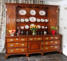 """A very good George III period large Oak Welsh Dresser with Mahogany mouldings and crossbandings, the upper part with a cavetto cornice above a shaped frieze and three lipped shelves flanked by panelled locking cupboards.  The base with 7 drawers around a central cupboard, opening to show a wine rack, the corners with quartered fluted columns and the whole raised on shaped bracket feet.   Circa 1780 H: 79"""", 201 cms, W: 88"""", 224 cms, D: 20.5"""", 52 cms."""