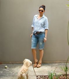 How to wear shorts over 40. Long denim shorts with a striped blue and white linen shirt