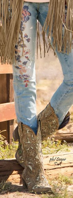Embroidered jeans and cowboy boots