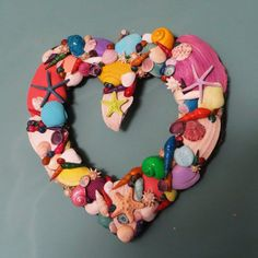 I am interested in the shape--not this execution.  Tropical colored sea shell heart by CarmelasCoastalCraft on Etsy, $65.00