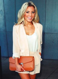 Molly King always looks amazing. Love this shorts and blazer combo with giant clutch