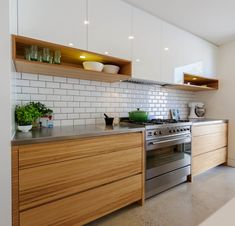 30 Fabulous Modern Kitchen Cabinet Design Ideas - Kitchen cabinets that hold and store pots, pans and other kitchen equipment have been the mainstay of any kitchen, throughout the ages. Kitchen Tiles Design, Kitchen Cabinet Design, Interior Design Kitchen, Interior Design Simple, Simple Kitchen Design, Backsplash Design, Kitchen Cabinet Doors Only, Modern Kitchen Cabinets, Scandinavian Kitchen Cabinets