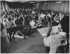 This photograph shows a presentation at the Black Power Forum which took place on the UNCG campus in November 1967. The three-day forum brought together speakers and panelists to discuss various aspects of the Black Power movement. This photograph appeared in the 1968 UNCG Pine Needles yearbook; the specific photographer is unknown.