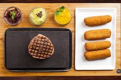 Brazilian tenderloin steak fillet cooked on lava stone, with homemade croquettes of cassava potato