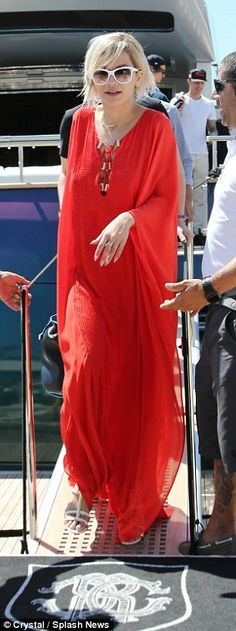 Rita Ora lounging on Roberto Cavalli's yacht while in Cannes, May 2014. Well heeled: The Shine Your Light hitmaker walked around barefoot whilst aboard the yacht ...