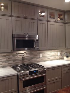 A 48 inch viking range with griddle a matching for Cece caldwell kitchen cabinets
