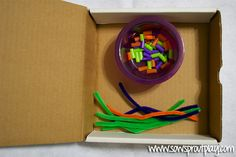 Beading Straws onto Pipe Cleaners Busy Box --add number cards to make sets for a math station!