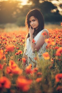 Beautiful young girl on poppy field with dress by Thomas Zsebok on 500px