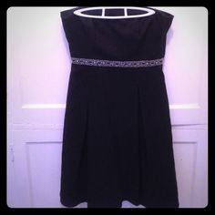 "Ann Taylor Petites strapless 100% silk black dress Perfect for weddings and events this summer. Strapless with jeweled ""belt"" at waist and a sheer ivory underskirt. Material is 100% silk. Lovely on. Bust 33"", waist 30"", hips 40"" SKU 070 Ann Taylor Dresses Strapless"