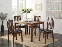 The Flihvine lovely casual dining set will give your dining room a slick update. Features a rectangular table with grooved solid top	 and square tapered legs. Four matching side chairs offer comfortable padded seat cushion covered in black faux leather	 and wooden backrest with vertical slat design. All carefully crafted with selected woods and veneers in walnut finish	 this set will blend nicely with any decor to create a beautiful dining room environment.