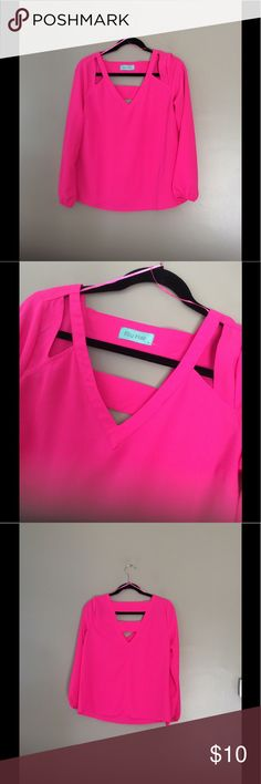 Hot Pink Deep V with cut outs blouse Hot pink blouse from Filly Flare. Has two cutouts (one at each shoulder) with deep V in front and back. V in back has two horizontal pieces to create a fun geometric look! Warn twice, cleaned per tag, great condition. Smoke free home. Bundle and save! 😃 Filly Flair Tops Blouses