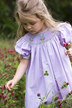 Love her English smocked dress. Depending on the patterns, hours of hand made work.