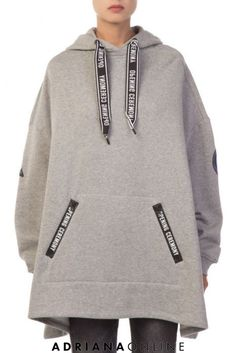 """Poncho-inspired oversized sweatshirt in soft heather grey cotton. Features drawstring hood, large kangaroo pocket at front and """"Opening Ceremony"""" lettering in black patches at back. Model is and is wearing a s Sporty Outfits, Sporty Style, Fall Outfits, Opening Ceremony, Hoodies, Sweatshirts, Clothes For Women, Inspired, Model"""