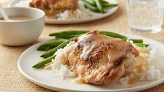 Slow Cooker Lemon Pepper Chicken - Slow-cooker ease and savory lemon pepper seasoning make these chicken thighs an irresistibly simple dinner. Serve over rice with a peppery lemon-garlic sauce for a perfect anytime meal. Slow Cooker Huhn, Slow Cooker Recipes, Low Carb Recipes, Crockpot Recipes, Chicken Recipes, Cooking Recipes, Pasta Recipes, Casserole Recipes, Jerky Recipes