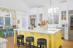 KitchenThe island is painted Tropical Moss by Dunn-Edwards Paints, while the black woven stools add a grounding element to the candy-colored space.