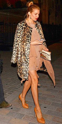 Love Her Outfit! | SIENNA MILLER | If we had space, we'd share the entire email chain between two editors gushing over Sienna's ensemble. But we don't, so we'll just say that her flowy mocha-hued dress goes perfectly with a more structured animal-print jacket and camel heels. And her messy topknot adds just the right I-didn't-try-too-hard vibe.
