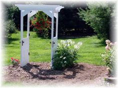 Old doors used for a delightful garden arbor. From jeannespines at Garden Junk forum on GardenWeb.