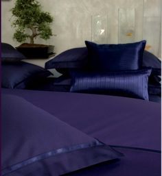 Alexandre Turpault:  GATSBY: Flat sheet, duvet cover, pillowcase, night blue cotton sateen, herringbone pattern, night blue satin ribbon finishing.  OSCAR:  Cushion, night blue satin ribbons finishing, back anthracite blue pure linen.  TEO:  Fitted sheet, night blue cotton sateen.