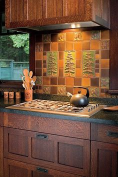 Love the quarter sawn wood Stunning ~ In an Arts Crafts Revival kitchen, an artistic tile panel by Handcraft Tile Co. and oak cabinets lend appeal to a kitchen with modern appliances. Photo by William Wright. Kitchen Art, Kitchen Backsplash, Kitchen And Bath, New Kitchen, Kitchen Cabinets, Oak Cabinets, Rustic Backsplash, Stone Kitchen, Kitchen Mosaic