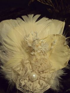 feathers,  lace, and dried flowers