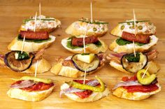 The Basque variety of Spanish Tapas is called 'Pintxos'. The rule is to eat a 'Pintxos' in two bites whilst standing. 'Pintxos' are always served on a slice of French bread or toast.