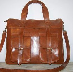 Leather travel bag sport bag tote laptop bag Tom in dark tan fits a15 inches laptop Unisex. $169.00, via Etsy.