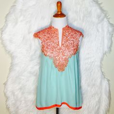 Esley Aqua Crochet Blouse This is the most gorgeous blouse ever! Coral, aqua & crocheted! Hi-low & open open back. NWOT Esley Tops Blouses